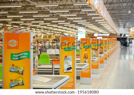 KRASNOGORSK, RUSSIA - MAY 17, 2014:  Checkout lane of Globus supermarket. The Globus supermarket in Krasnogorsk was opened at 30th November of 2013 - stock photo