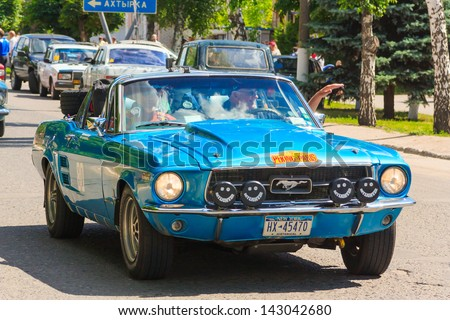 "KRASNOKUTSK, UKRAINE - JUNE 20: Vintage Ford Mustang participating in the ""Peking to Paris"" motor race, on June 20, 2013, in Krasnokutsk,  Ukraine"