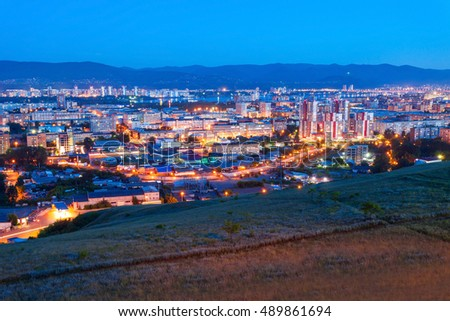 Krasnoyarsk city aerial panoramic view from Karaulnaya Mountain viewpoint in Krasnoyarsk at night, Russia
