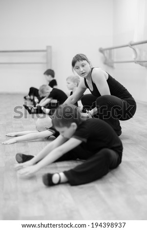KRASNOYARSK, RUSSIA - March 06, 2014: A group of boys working under the guidance of a young teacher dancing, choreography lesson