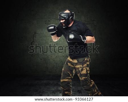 krav maga athete and grunge background - stock photo