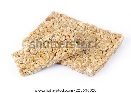 Krayasart, Thai dessert made of rice, nut, sesame-seeds and sugar on white background