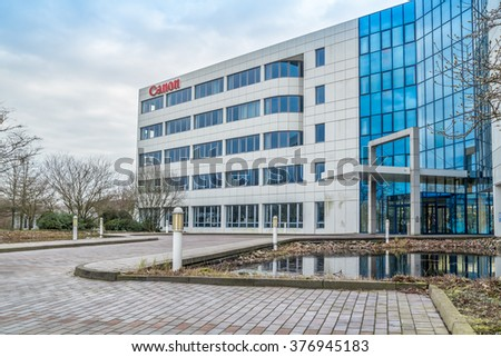 KREFELD / GERMANY - FEBRUARY 15 2016 : Canon office building under the clouds