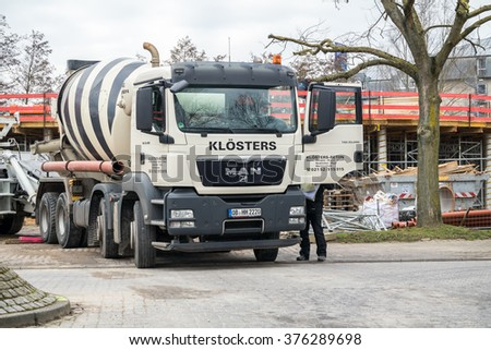 KREFELD / GERMANY - FEBRUARY 13 2016 : Concrete mixer waiting at the GOB Software construction site