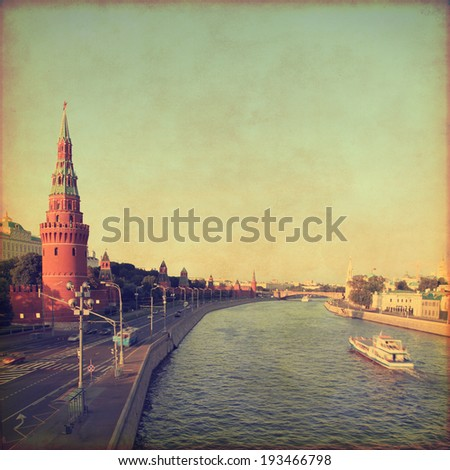 Kremlin and Moscow river in grunge and retro style.  - stock photo