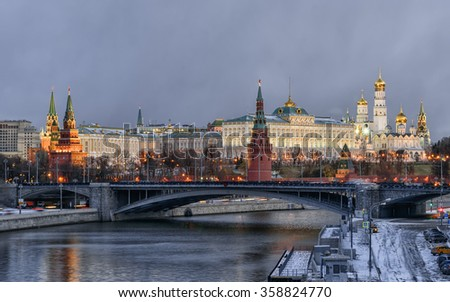 Kremlin embankment, Kremlin Wall, Grand Kremlin Palace. Bolshoy Kamenny Bridge. Morning blue hour winter shot. Moscow Russia - stock photo