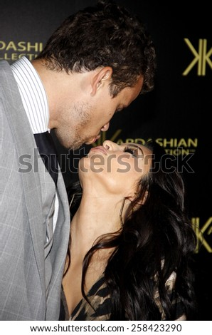 Kris Humphries and Kim Kardashian at the Kardashian Kollection Launch Party held at the Colony in Hollywood on August 17, 2011. - stock photo