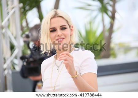 Kristen Stewart attends the 'Cafe Society' Photocall during The 69th Annual Cannes Film Festival on May 11, 2016 in Cannes, France. - stock photo
