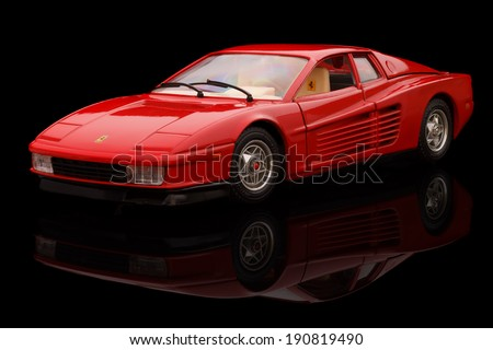 KRIVOY ROG, UKRAINE - APR 21- Toy ferrari testarossa 1984 on black background, Monday 21 April 2014 - stock photo