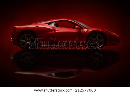 KRIVOY ROG, UKRAINE - AUG 22- Toy ferrari 458 Italia on red background, Friday 22 August 2014 - stock photo