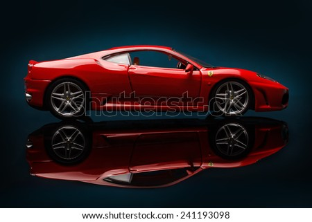 KRIVOY ROG, UKRAINE - DEC 25- Toy ferrari F430 on blue  background, Thursday 25 December 2014 - stock photo