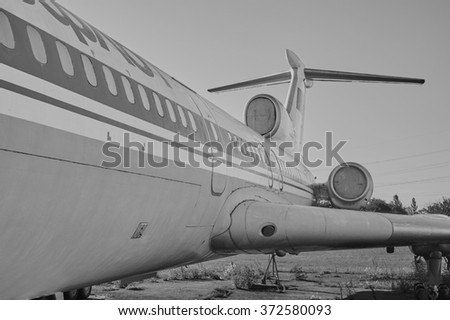 KRIVOY ROG, UKRAINE - FEBRUARY 5, 2016: Panoramic view of old soviet aircraft TU-154 Tupolev at an abandoned aerodrome. Black and white image