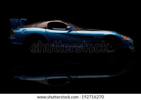 KRIVOY ROG, UKRAINE - JAN 04 - Toy blue dodge viper on black background, Saturday 4 January 2014