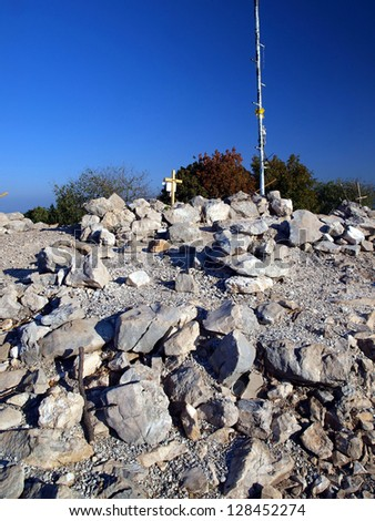 Krizevac stones near  of the apparitions of Our Lady in Medjugorje as a background - stock photo