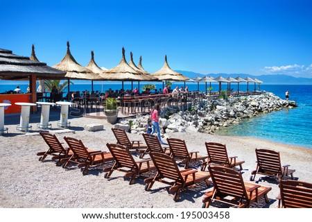 KRK, CROATIA, MAY 25 : People enjoying at the beach bar on May. 25, 2014  at island Krk, Croatia. Tourist place at the Croatian coast. Krk is one of the biggest island in Croatian coast.  - stock photo