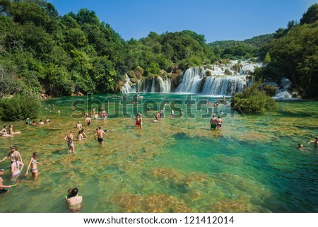 KRKA, CROATIA - JULY 28, 2012: People on the lake on July 28, 2012 in Krka, Croatia. The Krka National Park is one of eight national parks in Croatia.
