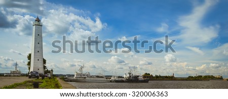 KRONSTADT, RUSSIA - AUGUST 23, 2014: Panoramic view from the promenade to the pier with a lighthouse and anchored ships in Kronstadt, Russia