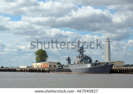 Kronstadt, Russia - July 14, 2016: Grey modern warship at the mooring with a wooden beacon
