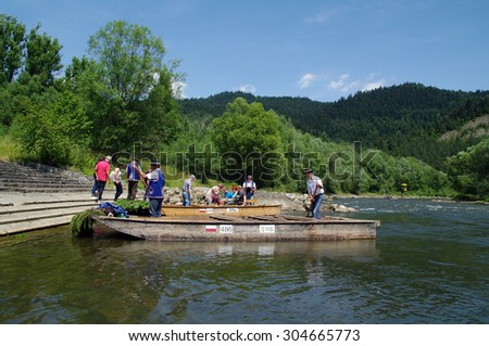 KROSCIENKO NAD DUNAJCEM, POLAND - 12.07.2015 The rafting at the river Dunajec.The river forms the border between Slovakia and Poland.