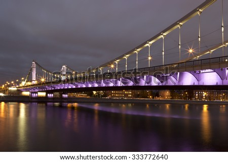 Krymsky Bridge or Crimean Bridge at night is a steel suspension bridge in Moscow, Russia. - stock photo