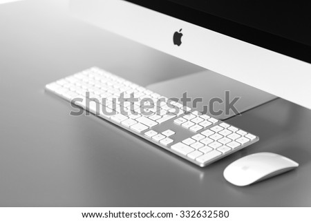 Krynica - Zdroj, POLAND - August 19 , 2015: Photo of new iMac Retina 5k, With OS X Yosemite on table in office. iMac - monoblock series of personal computers, created by Apple Inc. - stock photo