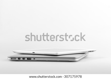 KRYNICA-ZDROJ, POLAND - MARCH 17, 2015: Macbook and Ipad photographed on a table at home - stock photo