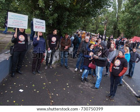 Kryvyi Rih, Ukraine - October 9, 2017: Kryvyi Rig citizens at protest meeting near the ArcelorMittal Kryvyi Rih claim to reduce air pollution and conduct an independent audit of cleaning equipment