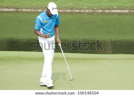 KUALA LUMPUR - APRIIL 14: Shaaban Hussin of Malaysia make birdie at hole 16 during Maybank Malaysian Open 2012 at Kuala Lumpur Golf & Country Club on April 14, 2012
