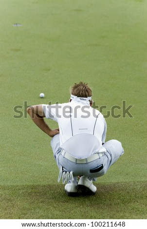 KUALA LUMPUR - APRIL14: Jbe Kruger of South Africa lines up a putt on the 16th green during 3rd round match Maybank Malaysian Open 2012 at Kuala Lumpur Golf & Country Club on April 14, 2012
