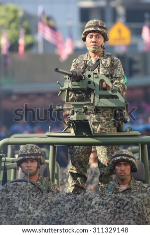 KUALA LUMPUR-Aug 28: A Malaysia Army soldier manning the Heavy Machine Gun (HMG) with a calibre 12.7 MM during rehearsal for National Day parade on Aug 28,2015 at Dataran Merdeka,Kuala Lumpur,Malaysia - stock photo