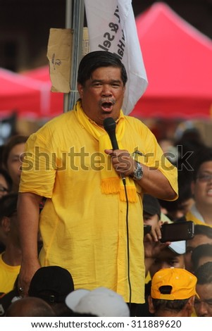 KUALA LUMPUR - Aug 30 : Mat Sabu, a prominent opposition leader giving speech during Bersih 4.0 rally which demand fair and clean election on Aug 30, 2015 in Dataran Merdeka, Kuala Lumpur, Malaysia - stock photo