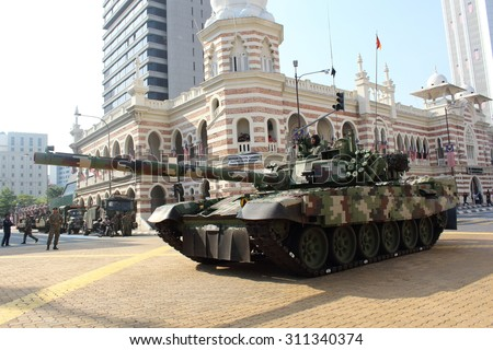 KUALA LUMPUR -  Aug 28 : Pendekar 125 MM battle tank cruise the road  during the rehearsal for National Day parade on Aug 28,2015 in front Textile Museum ,Dataran Merdeka, Kuala Lumpur, Malaysia - stock photo