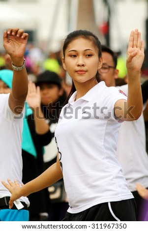 KUALA LUMPUR - Aug 27 : Unidentified young woman dancing during the rehearsal for National Day parade on Aug 27,2015 in front of Bangunan Sultan Abdul Samad ,Dataran Merdeka, Kuala Lumpur, Malaysia - stock photo