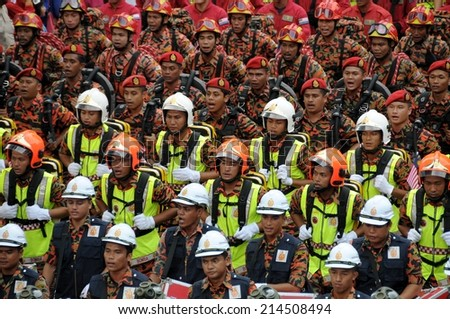 KUALA LUMPUR - AUGUST 31: Firefighter department during 57th Celebrations, Malaysian Independence Day Parade on August 31, 2014 in Kuala Lumpur, Malaysia.  - stock photo