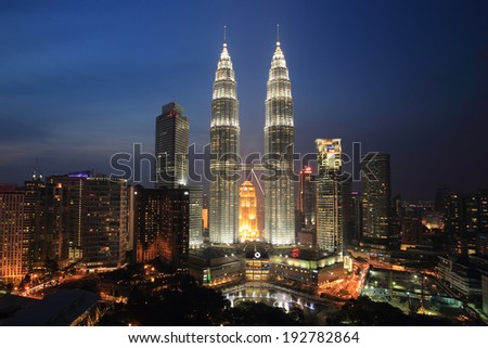KUALA LUMPUR - August 22: The Petronas Twin Towers on August 22, 2013, in Kuala Lumpur, Malaysia are the world's tallest twin tower. The skyscraper height is 451.9m  - stock photo