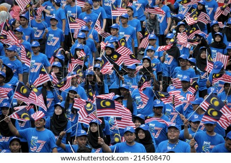 KUALA LUMPUR - AUGUST 31: Youth associations during 57th Celebrations, Malaysian Independence Day Parade on August 31, 2014 in Kuala Lumpur, Malaysia.  - stock photo