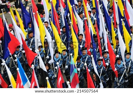 KUALA LUMPUR - AUGUST 31: Youth from national service camp during 57th Celebrations, Malaysian Independence Day Parade on August 31, 2014 in Kuala Lumpur, Malaysia.  - stock photo