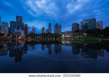 Kuala Lumpur city blue hour scenic view with reflection of the building over the water.