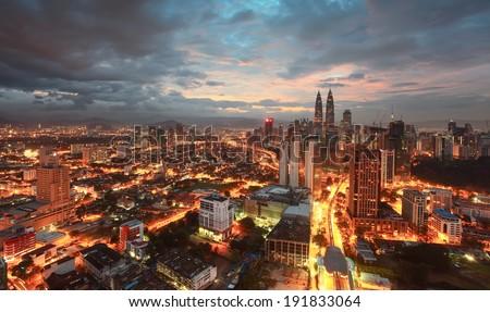 Kuala Lumpur City Centre during beginning of Sunrise - stock photo