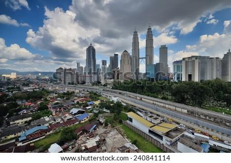 Kuala Lumpur city skyline during hot day - stock photo