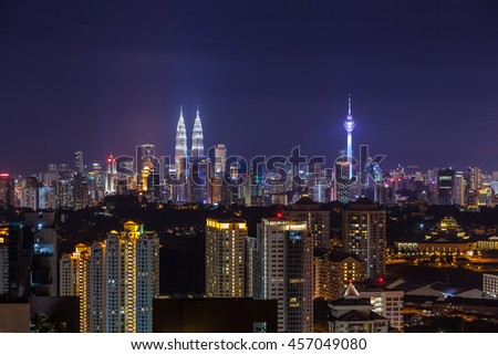 Kuala Lumpur city skyline vibrantly lit at dusk, viewed from east 2