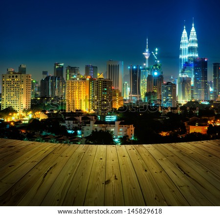 Kuala Lumpur city view and wooden floor. - stock photo