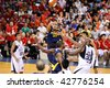 KUALA LUMPUR - DECEMBER 13: KL Dragons defends an attack by Thailand Tigers in the ASEAN Basketball League match. December 13, 2009 in Kuala Lumpur. - stock photo