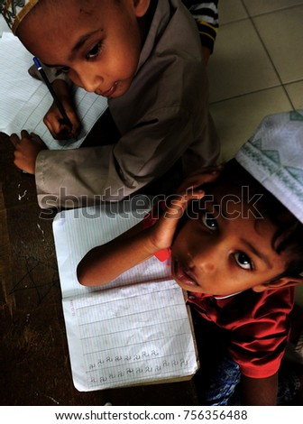 Kuala Lumpur - December 16th 2016, Potrets of Rohingya children during study session at Madhrasah Hashimiah.  About 62,513 Rohingya people fled from Myanmar to Malaysia as of September 2017