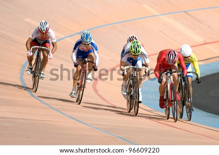 KUALA LUMPUR, FEB 12: A female riders from various Asian countries participate in the track event during the Asian Cycling Championships 2012 at Kuala Lumpur Velodrome, Malaysia on February 12, 2012. - stock photo