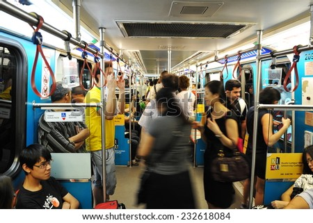 KUALA LUMPUR - FEB 15: Commuters travel on a city subway train on Feb 15, 2012 in Kuala Lumpur, Malaysia. The Malay capital was founded in 1859 and is now home to over 1.6 million people. - stock photo