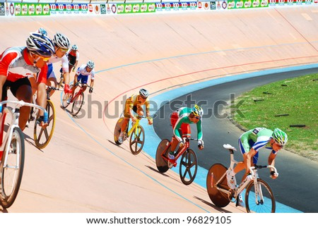 KUALA LUMPUR-FEB 11: Riders from various Asian countries participate in the track event during the Asian Cycling Championships 2012 at Kuala Lumpur Velodrome, Malaysia on February 11, 2012