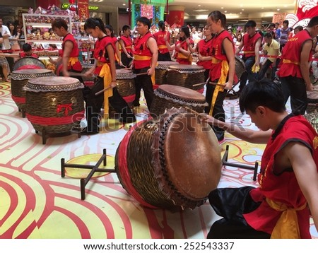 KUALA LUMPUR - FEBRUARY 14: Chinese lion dance troupe drum performance in celebration of upcoming Chinese New Year celebrations in Kuala Lumpur February 14, 2015