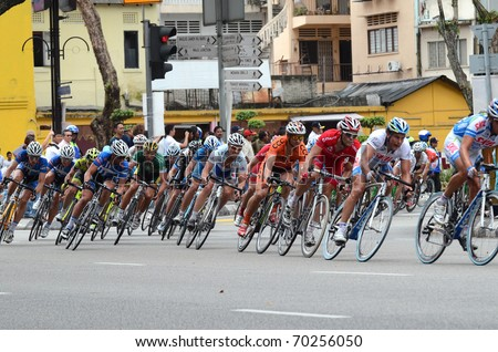 KUALA LUMPUR - FEBRUARY 1 : Cyclists participate in the Le Tour de Langkawi cycling race on February 1, 2011 in Kuala Lumpur, Malaysia.