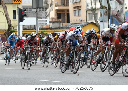 KUALA LUMPUR - FEBRUARY 1 : Cyclists participate in the Le Tour de Langkawi cycling race on February 1, 2011 in Kuala Lumpur, Malaysia. - stock photo